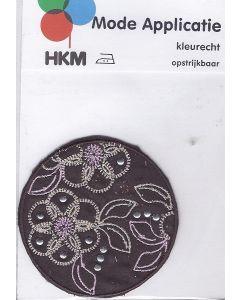 Bruin, rond met bloemetjes print en zilvere steentjes applicatie.