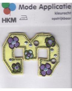 Gele 3 met bloemen applicatie.